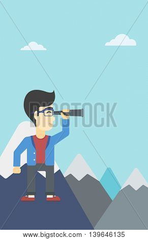 An asian businessman standing on the top of mountain with spyglass. Young businessman looking for success and business opportunities. Vector flat design illustration. Vertical layout.