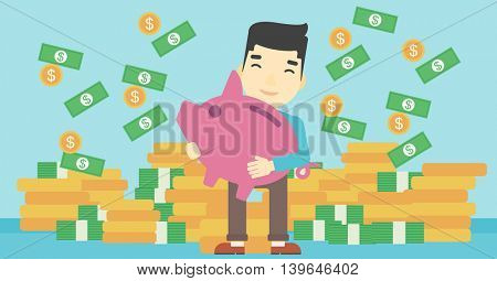 An asian happy young businessman holding a big piggy bank in hands under money rain on the background of stacks of gold coins. Vector flat design illustration. Horizontal layout.