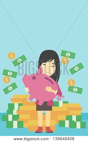An asian young business woman holding a big piggy bank in hands under money rain on the background of stacks of golden coins. Vector flat design illustration. Vertical layout.
