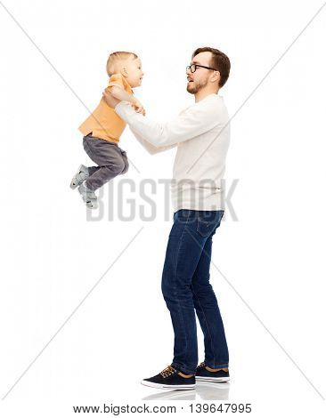 family, childhood, fatherhood, leisure and people concept - happy father and little son playing and having fun