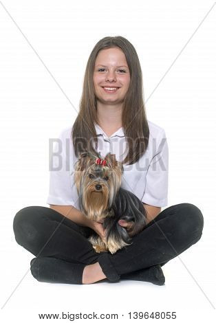 young yorkshire terrier and teen in front of white background