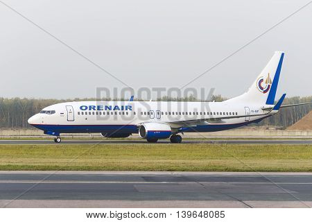 MOSCOW, RUSSIA - SEPTEMBER 26, 2014: Orenair airlines Boeing-737 taxiing. Plane makes taxiing on taxiway Domodedovo International Airport.