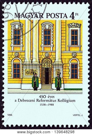HUNGARY - CIRCA 1988: A stamp printed in Hungary issued for the 450th anniversary of Debrecen Calvinist College shows the facade, circa 1988.