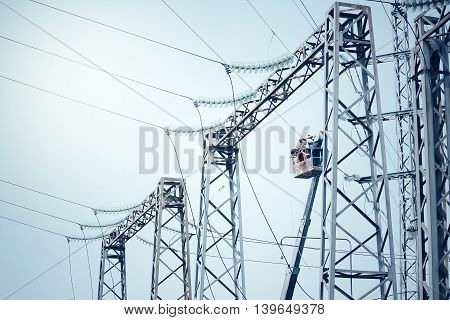 Power transformer substation. Technology installation blue colour background.