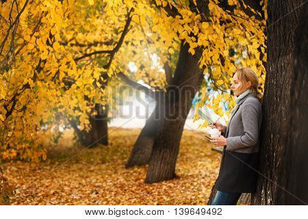 Woman Walking With Coffee And Note
