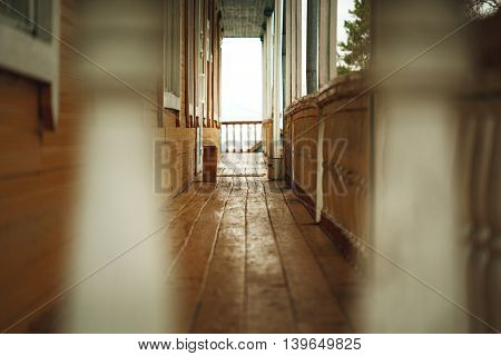Old Wooden Terrace In Front Of Abandoned House
