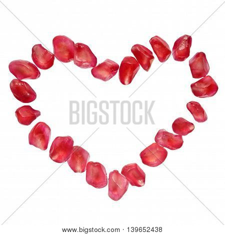 Heart shaped pomegranate seeds isolated on white. Love passion symbol super food concept