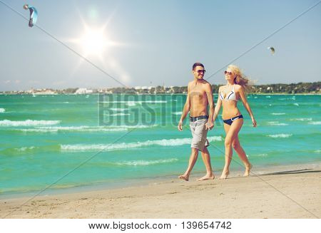 picture of happy couple walking on the beach.