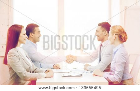 business and office concept - smiling business team having meeting in office