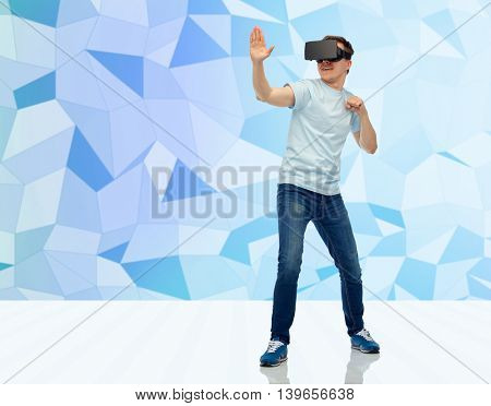 3d technology, virtual reality, entertainment, cyberspace and people concept - young man with virtual reality headset or 3d glasses playing game and fighting over low poly background