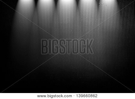 black metal mesh with spotlight background