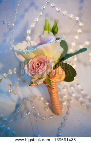 Men's Wedding boutonniere on a blue background