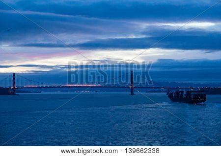 A freighter sailing into San Francisco harbor at night