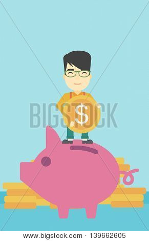 An asian young businessman saving money by putting a coin in a big piggy bank on a background of stacks of gold coins. Vector flat design illustration. Vertical layout.