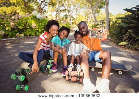 Happy family are taking a selfie at park