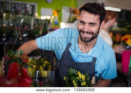 Male florist arranging flower bouquet in the flower shop