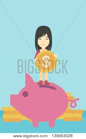 An asian young business woman saving her money by putting a coin in a big piggy bank on a background of stacks of gold coins. Vector flat design illustration. Vertical layout.