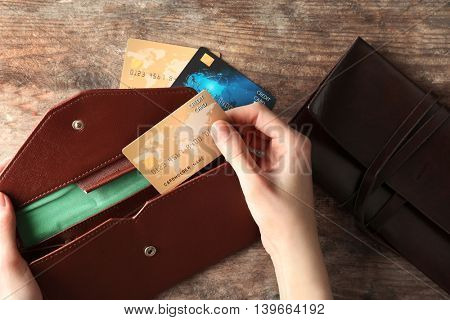 Woman taking credit card of the purse