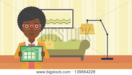 An african-american woman showing a tablet computer with smart home application on a screen on the background of living room. Vector flat design illustration. Horizontal layout.