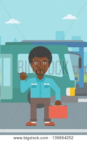 An african-american young man standing at the entrance door of a bus on a city background. Young man waving in front of a bus. Vector flat design illustration. Vertical layout.