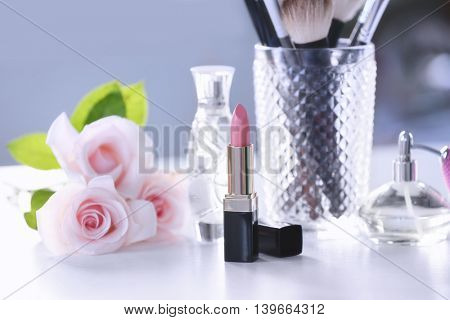 Opened lipstick on white dressing table