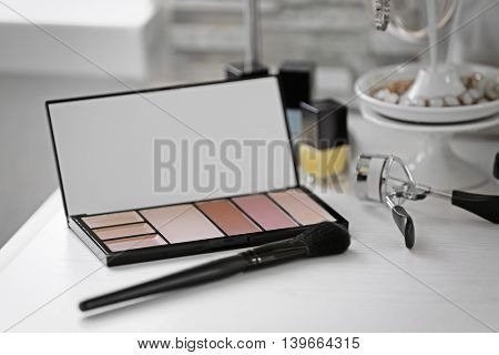 Eye shadow on light dressing table, close up