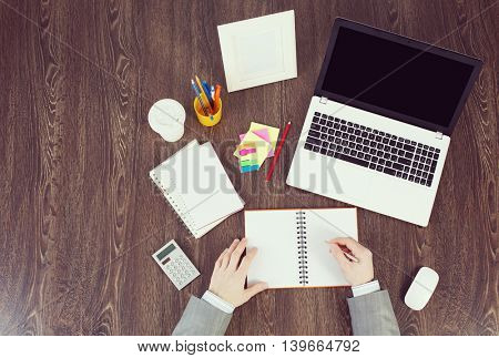 Office workplace with office supplies and laptop