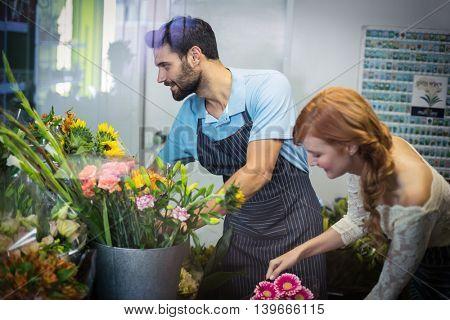 Couple arranging flower bouquet in the flower shop