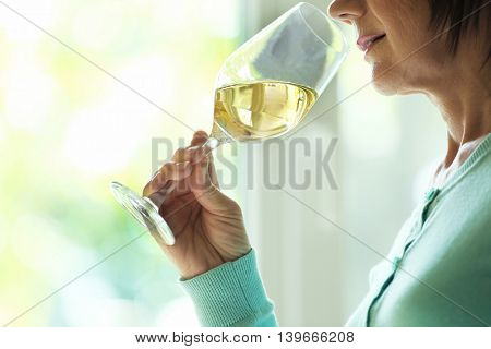 Woman tasting white wine