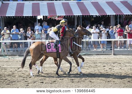 SARATOGA SPRINGS, NY - July 22: Fun in the Post Parade for the 98th runniing of the Schulerville Stakes for 2 year old Fillys on July 22 in Saratoga Springs, NY.