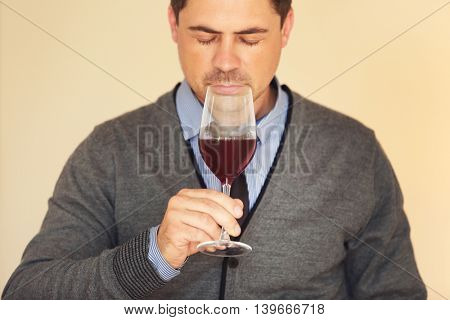 Handsome man tasting wine