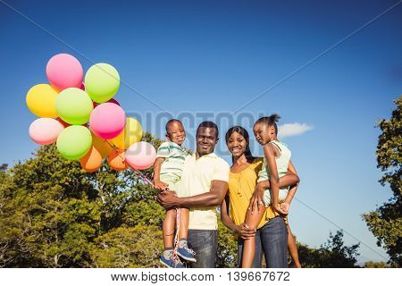 Happy family posing together at park