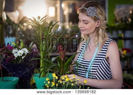 Female florist preparing flower bouquet in the shop