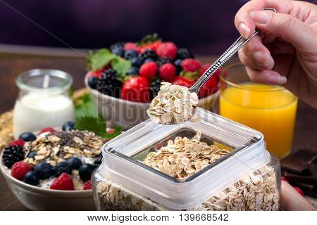 Spoon Of Oatmeal. Bowl With Berries.