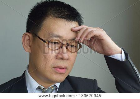 A sad looking asian business man portrait