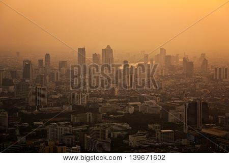 View Across Bangkok Skyline Showing In Sunset