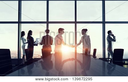 Silhouettes of Business People in Office.   . Mixed media