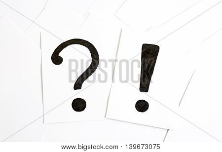 Question And Exclamation Mark On The Paper