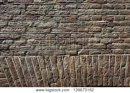 Wall of red bricks. Old masonry background texture