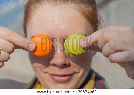 Girl Holding A Near Eye Macaroon Cake