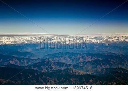 flying over the Himalaya in the morning with sunrise