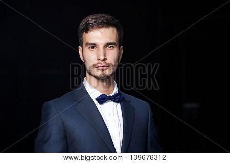 Elegant man on dark background