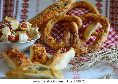 Savory pastries pretzel loaf of bread rolls homemade mini hot dogs and ears of barley