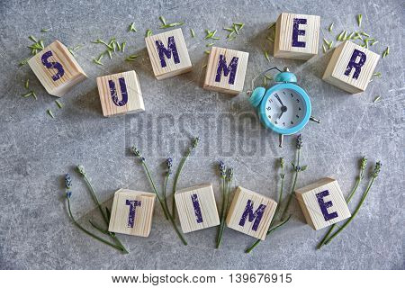 Wooden cubes with flowers on a color background. Summer time concept