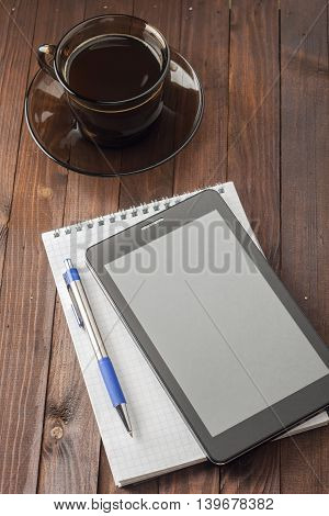 Tablet Computer Is On Notepad With A Pen, Standing Next To A Cup Of Coffee.