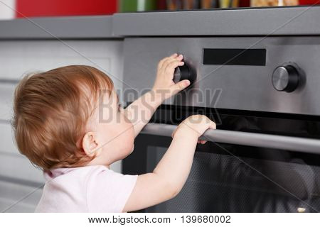 Child playing with electric oven