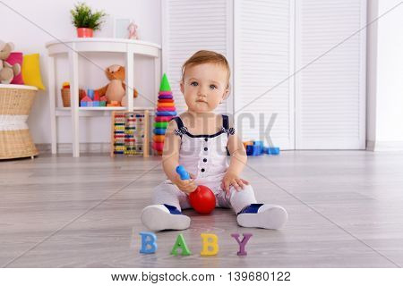 Baby playing with toys in room