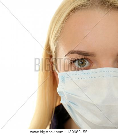 Woman wearing mask isolated on white