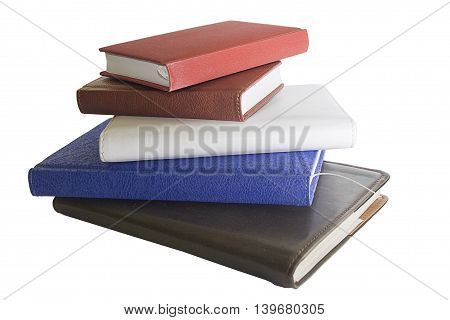 stack of notebooks in different colors and sizes isolated on the white