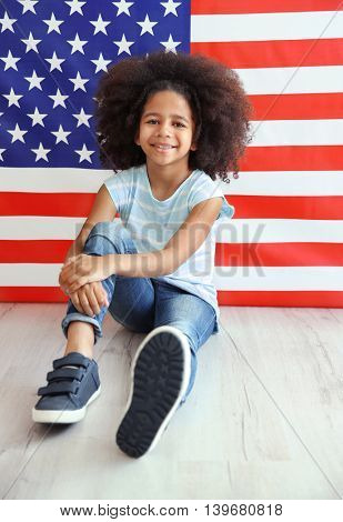 Afro-American girl on American flag background